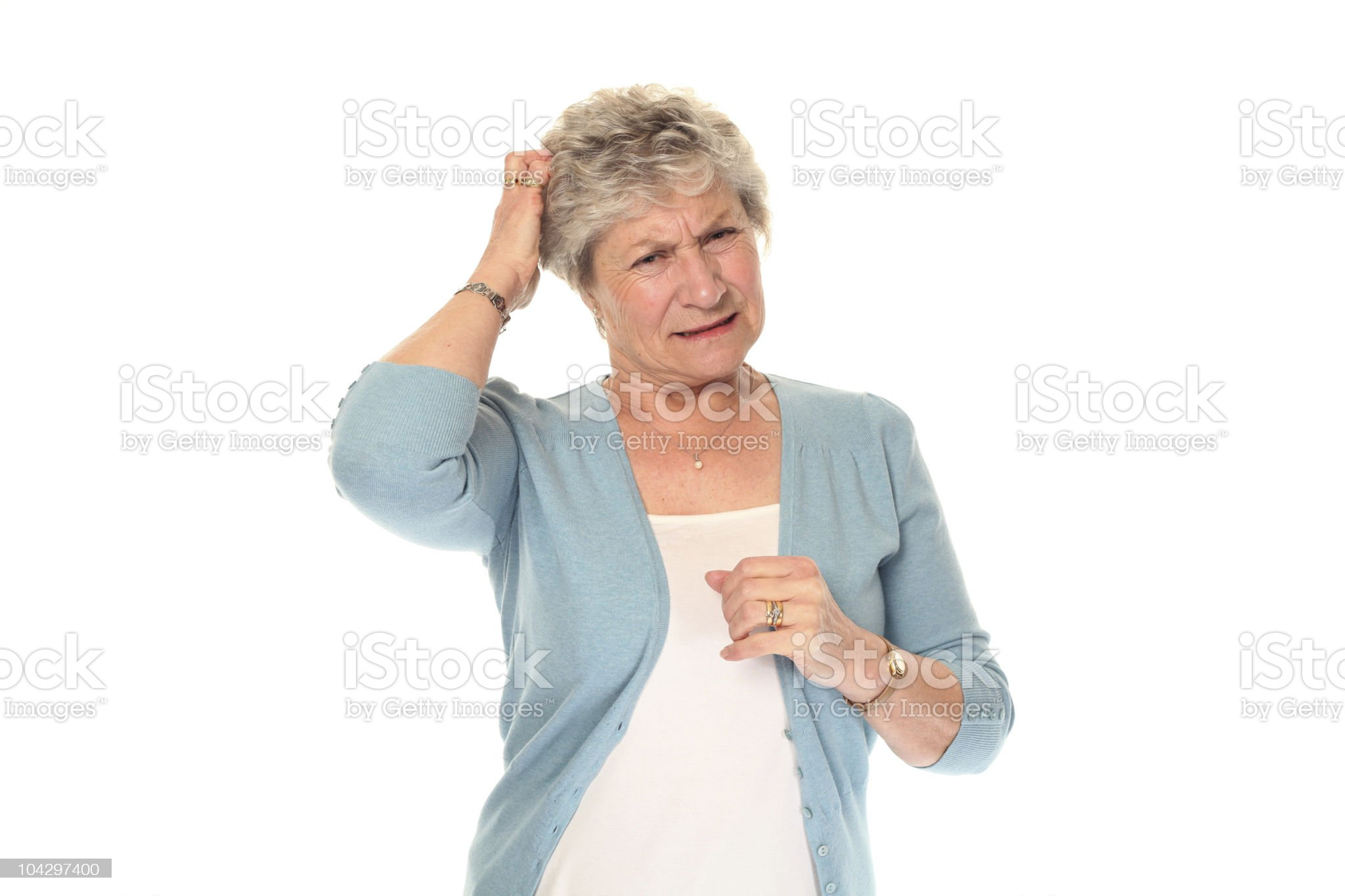 Senior older woman scratching head royalty-free stock photo