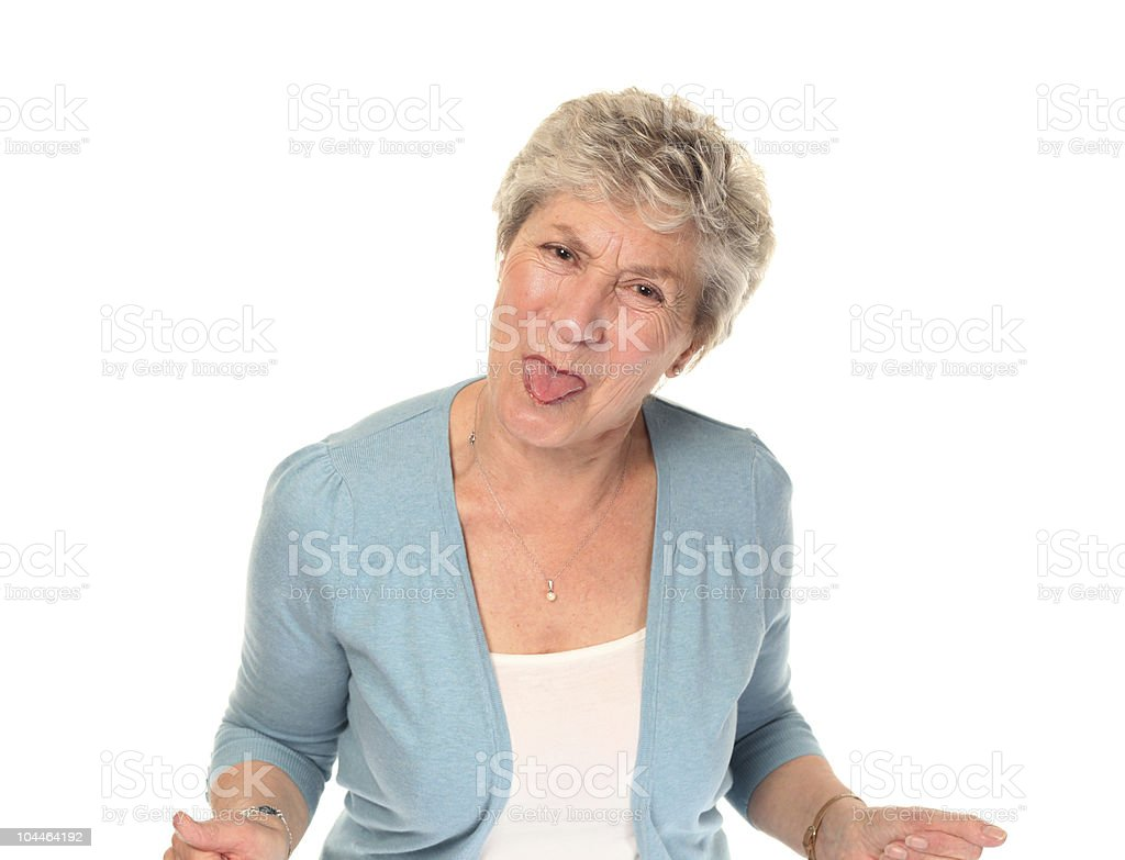 Senior older woman sticking out tongue stock photo