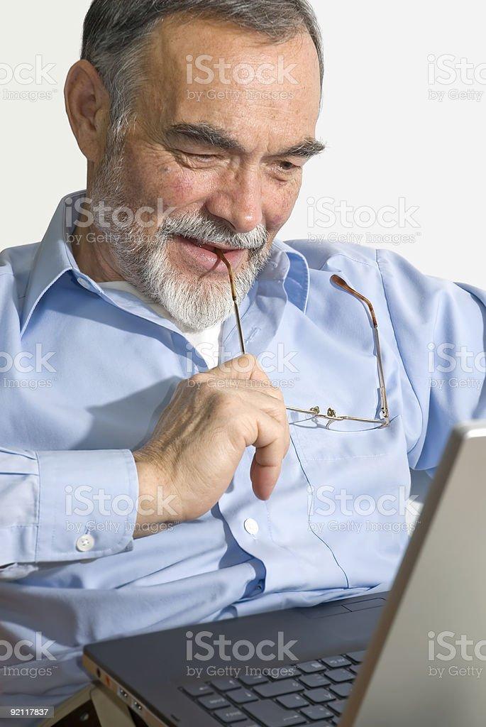 Senior on laptop royalty-free stock photo