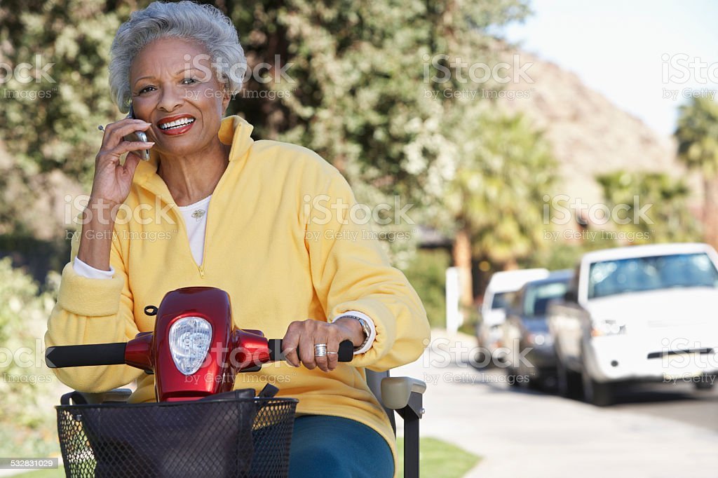 Senior on mobility scooter stock photo