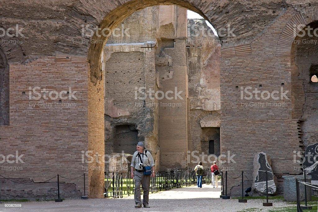 senior on visit to Rome's ruins stock photo