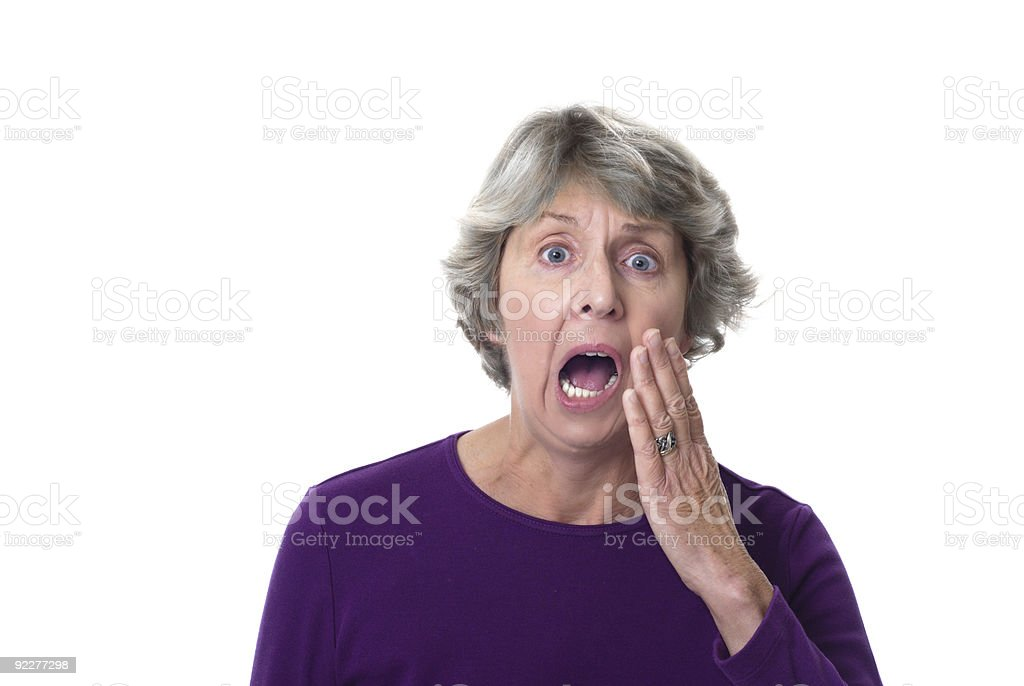Senior or mature woman screeching in pain with toothache. stock photo