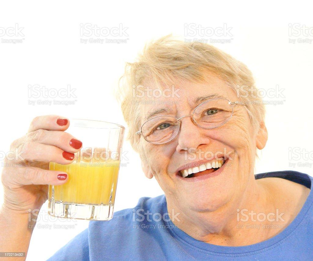 senior - orange juice royalty-free stock photo