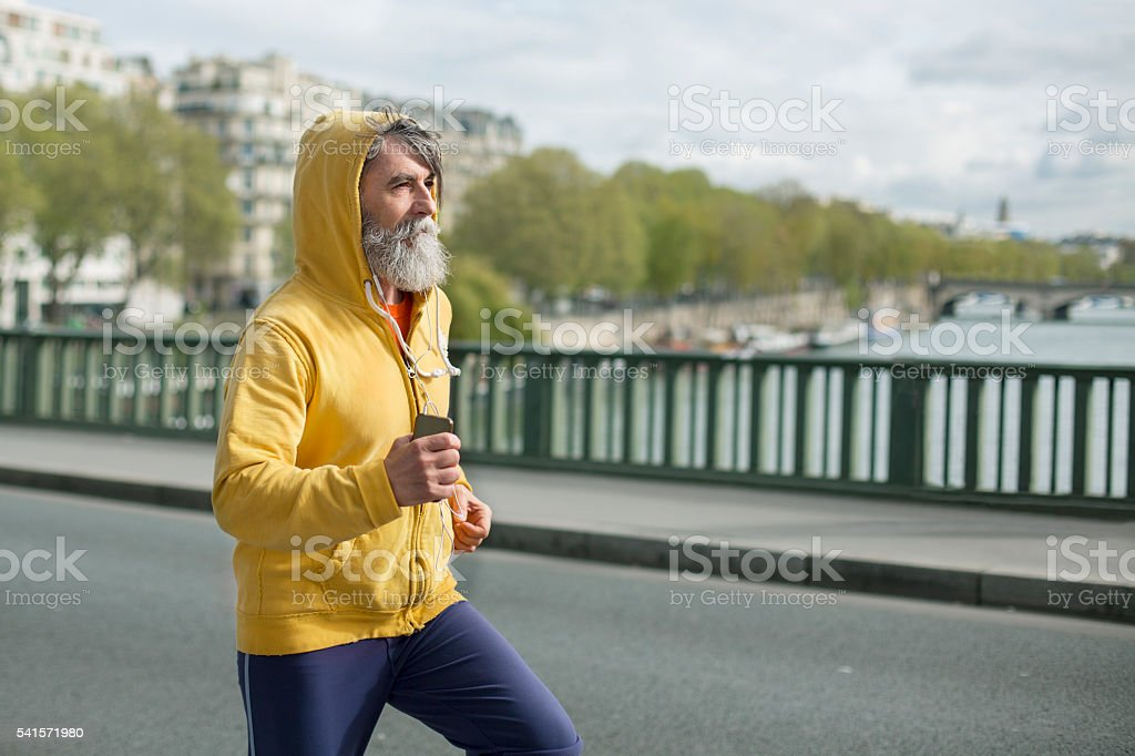 Senior out for a run in the city stock photo