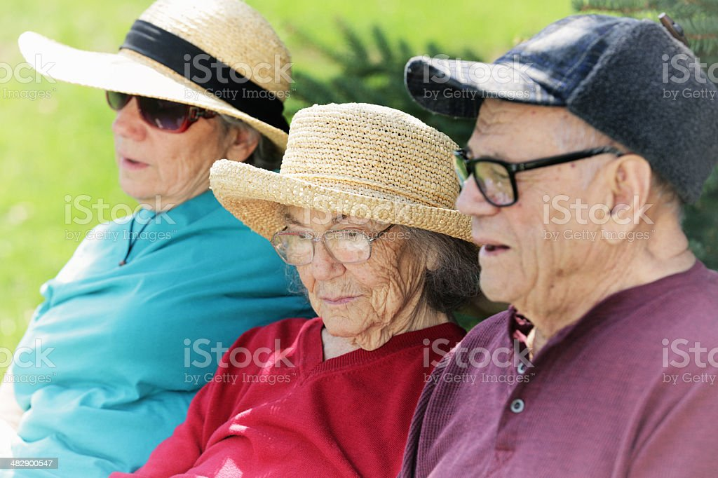 Senior Parents and Daughter Daydreaming royalty-free stock photo