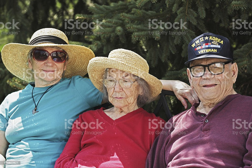 Senior Parents and Daughter With Hats stock photo