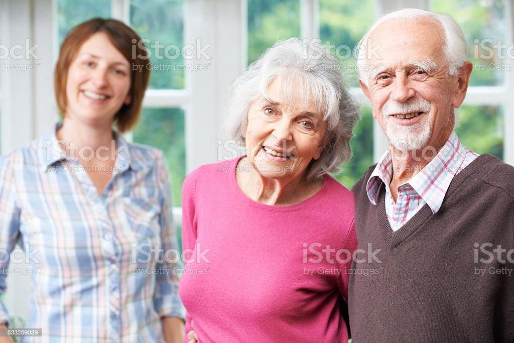 Senior Parents With Adult Daughter At Home stock photo