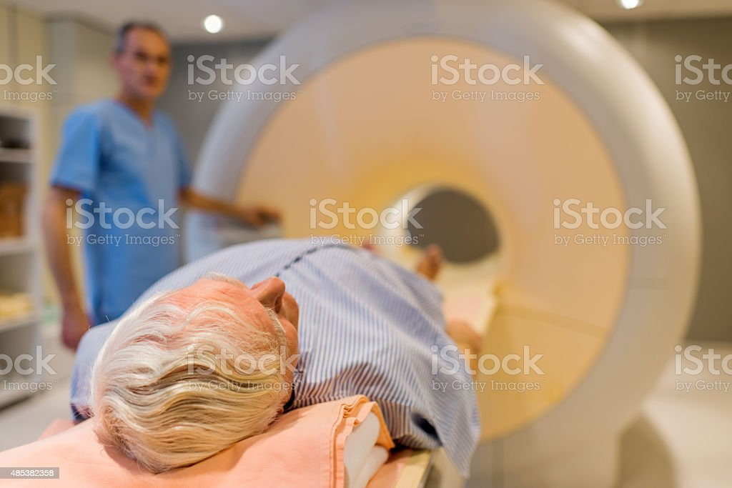 Senior patient about to receive an MRI scan. stock photo