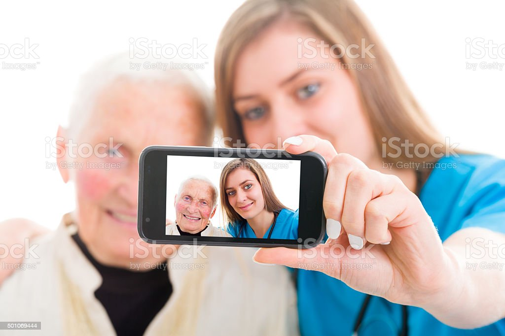 Senior patient and young doctor self portrait stock photo