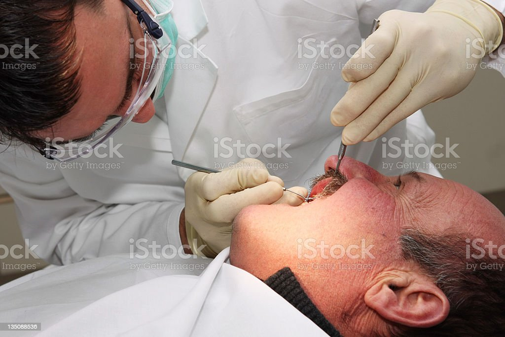 Senior patient at the dentist stock photo