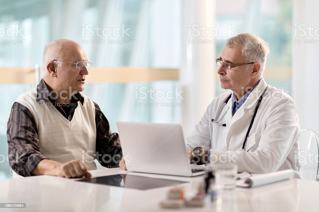Senior patient having an appointment at doctor's office. stock photo