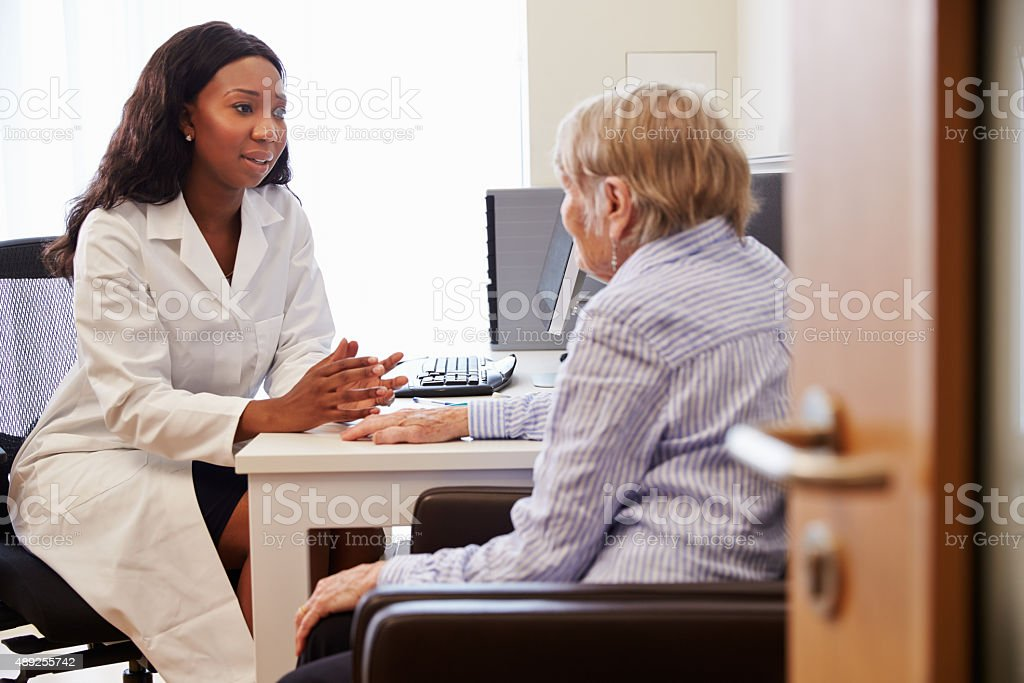 Senior Patient Having Consultation With Doctor In Office stock photo