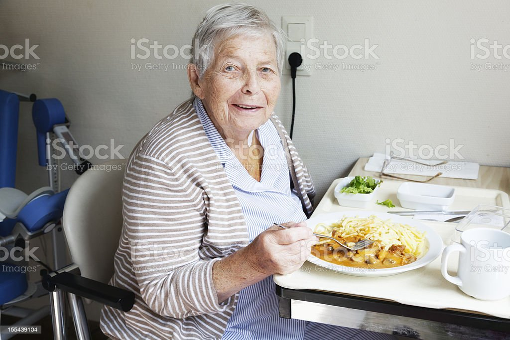 senior patient hospital eating stock photo