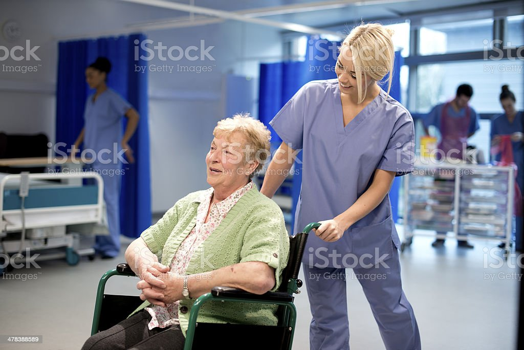 senior patient leaves hospital stock photo