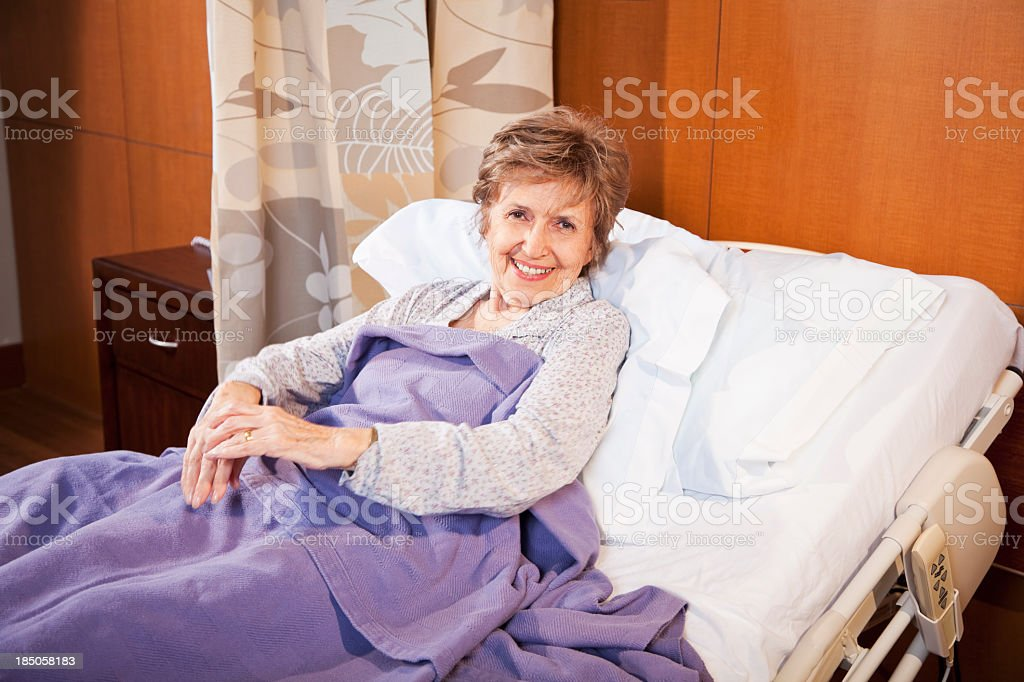 Senior patient lying in hospital bed royalty-free stock photo