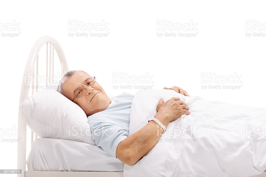 Senior patient lying on a hospital bed stock photo