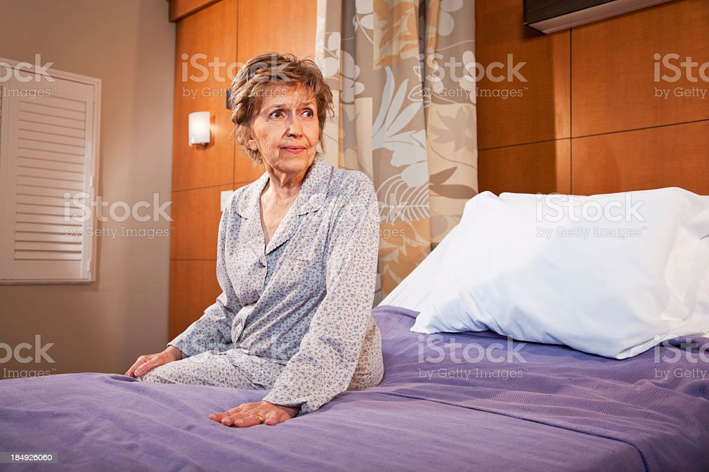 Senior patient sitting on hospital bed royalty-free stock photo