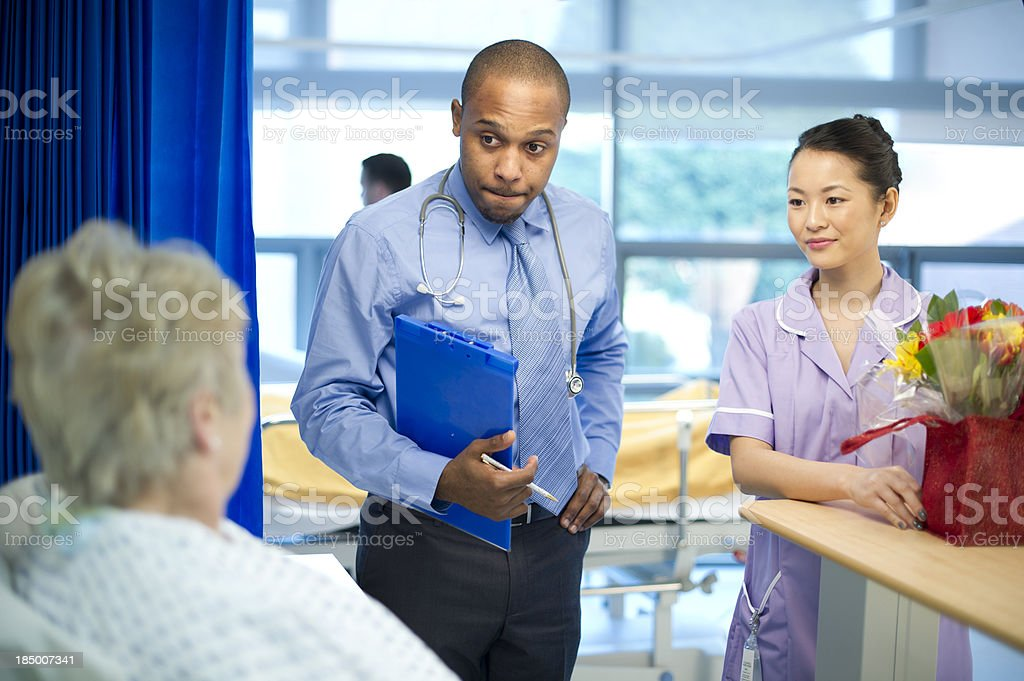 senior patient speaking to doc royalty-free stock photo