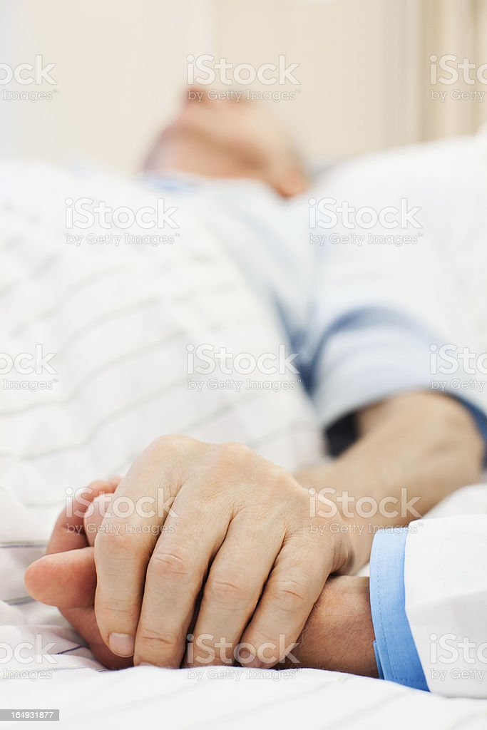 Senior patient taken care of a doctor stock photo