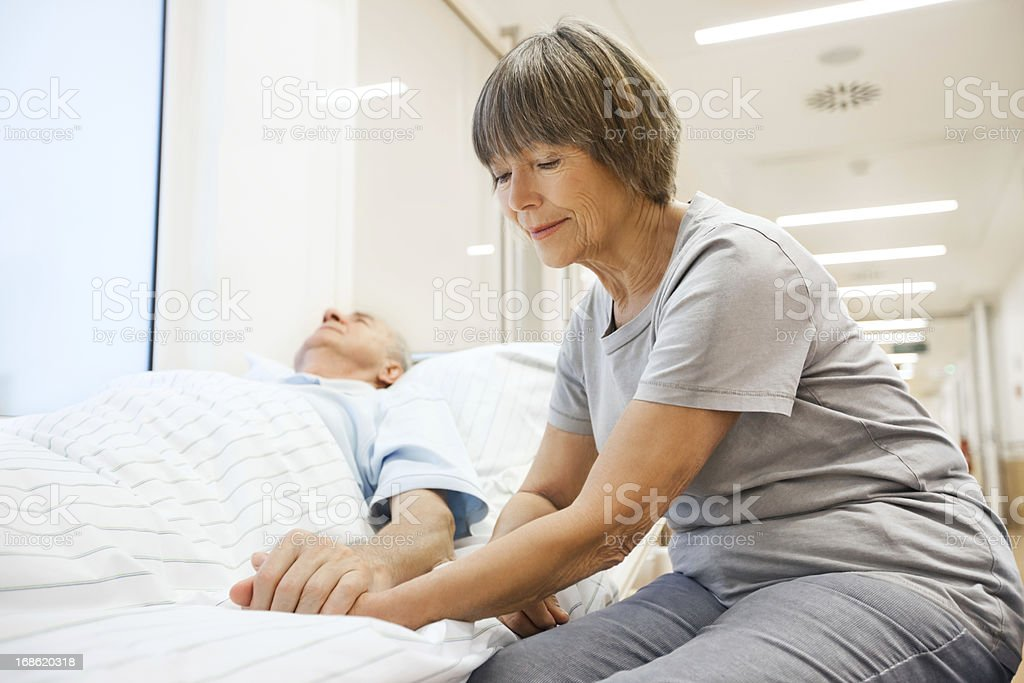 Senior patient taken care of by his wife stock photo