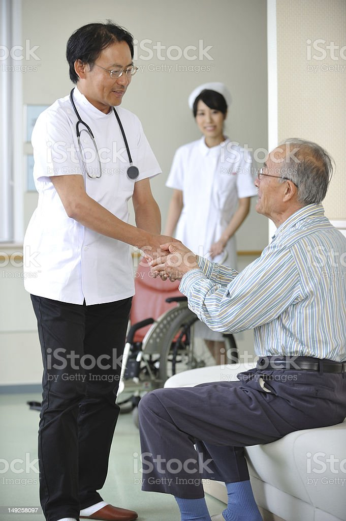 Senior Patient with Doctor in a Hospital Waiting Room royalty-free stock photo