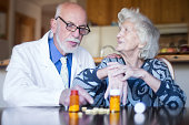 Senior patient with her doctor, home healthcare