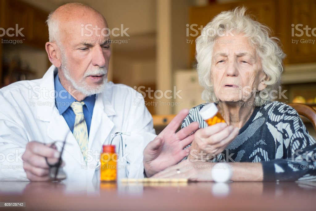Senior patient with her doctor, home healthcare stock photo