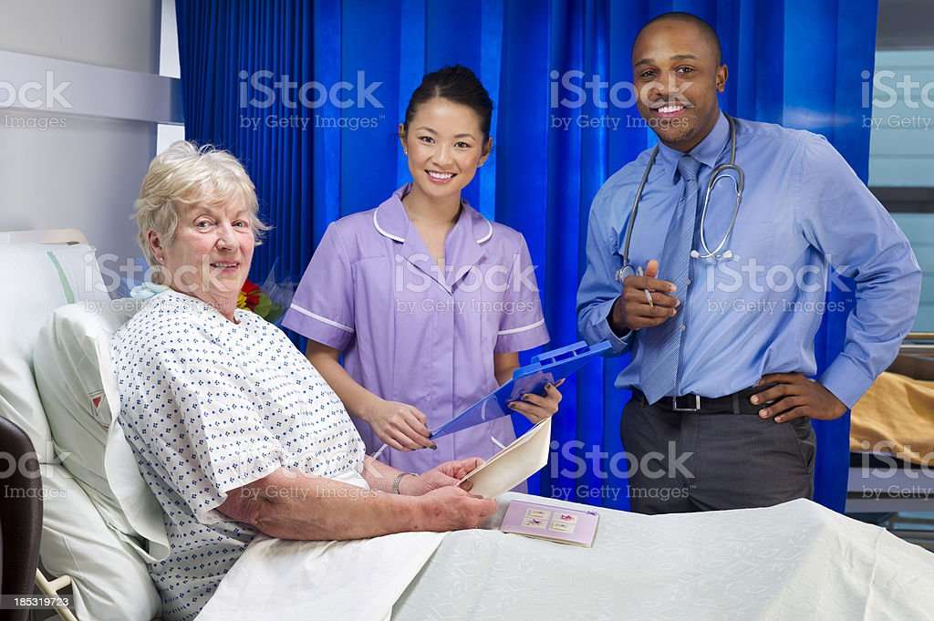 senior patient with medical staff royalty-free stock photo