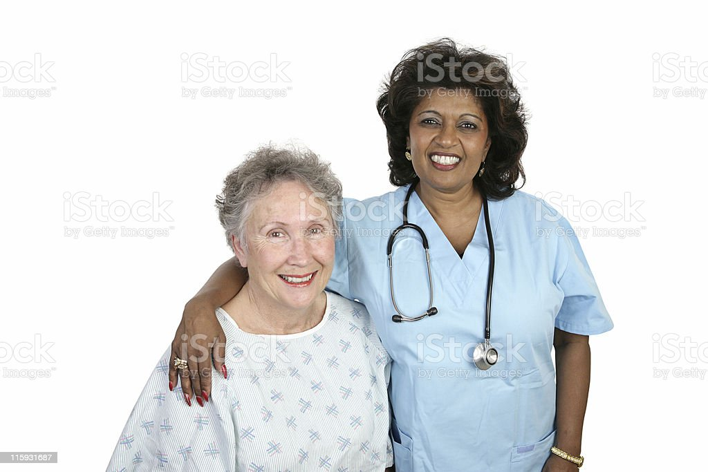 Senior patient with nurse, smiling royalty-free stock photo