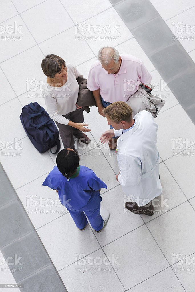 Senior Patients being greeting by Doctors stock photo