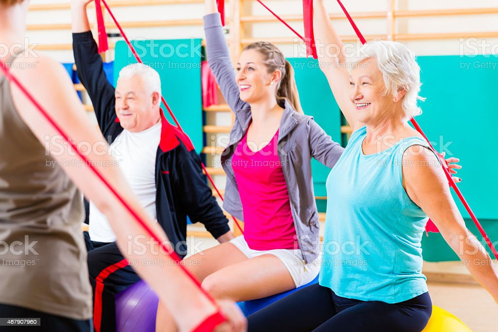 Senior people at fitness course in gym stock photo
