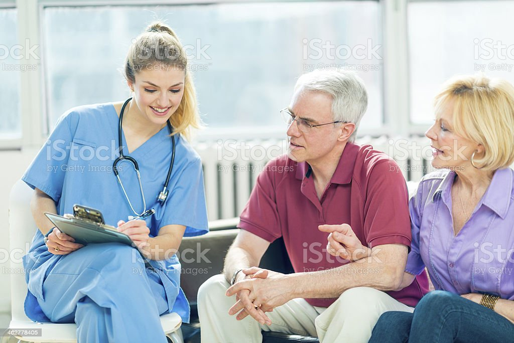 Senior people consulting in clinic stock photo