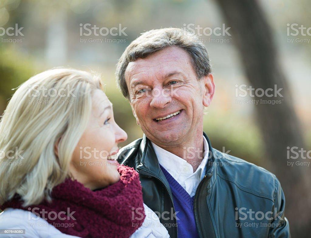 Senior people flirting and laughing stock photo