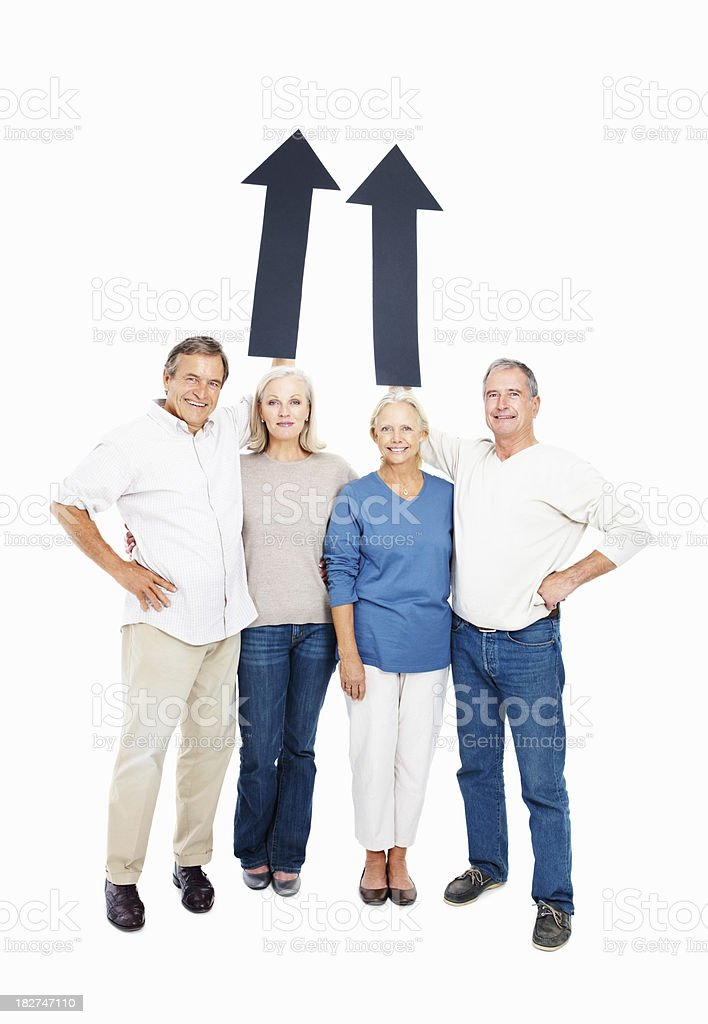 Senior people holding arrow signs at copyspace on white royalty-free stock photo