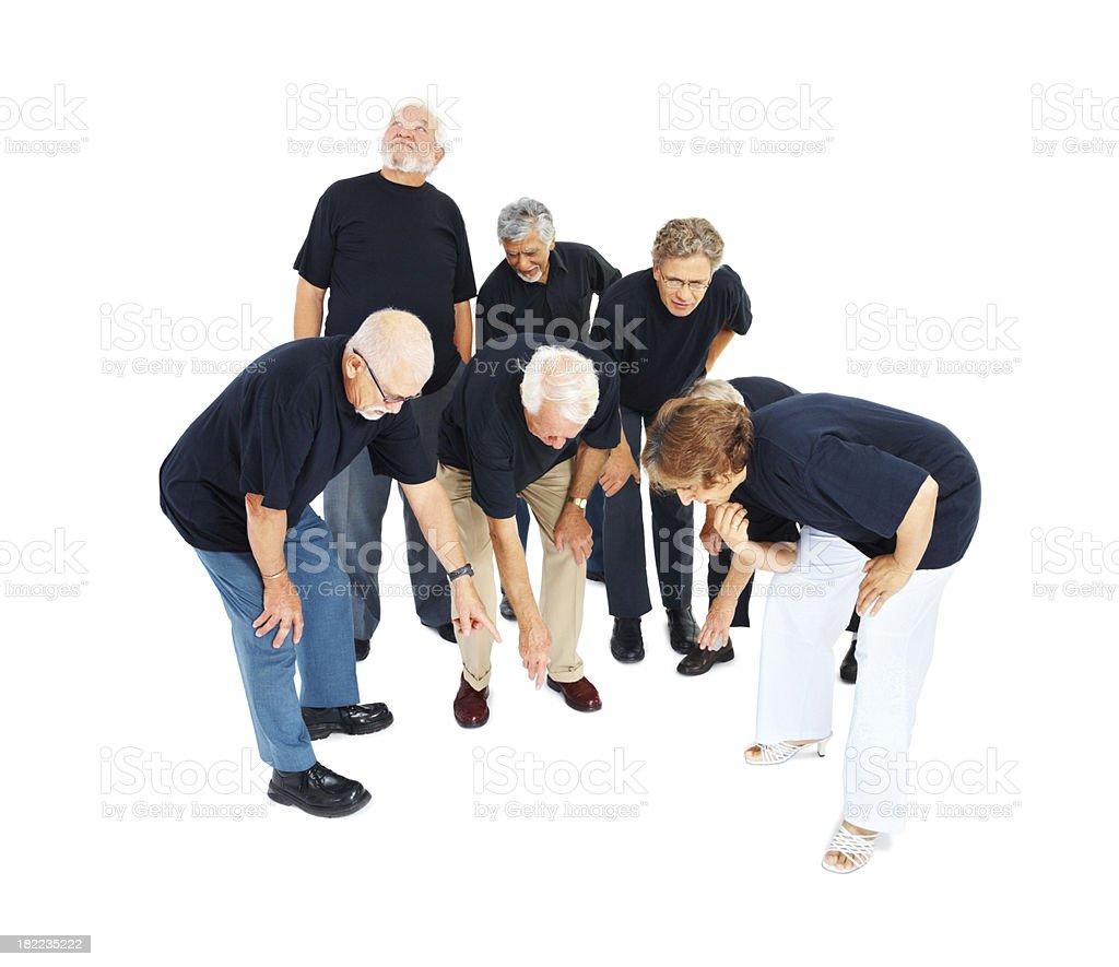 Senior people searching something on floor royalty-free stock photo