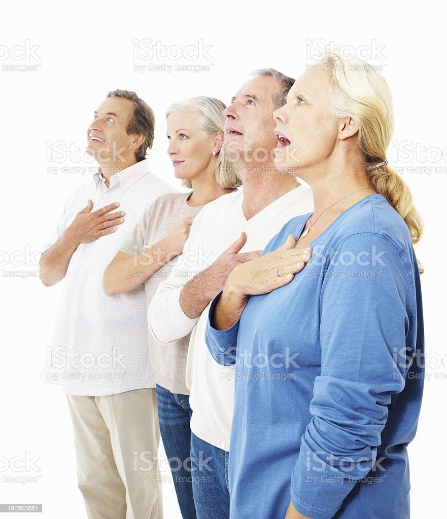 Senior people singing the National Anthem against white stock photo