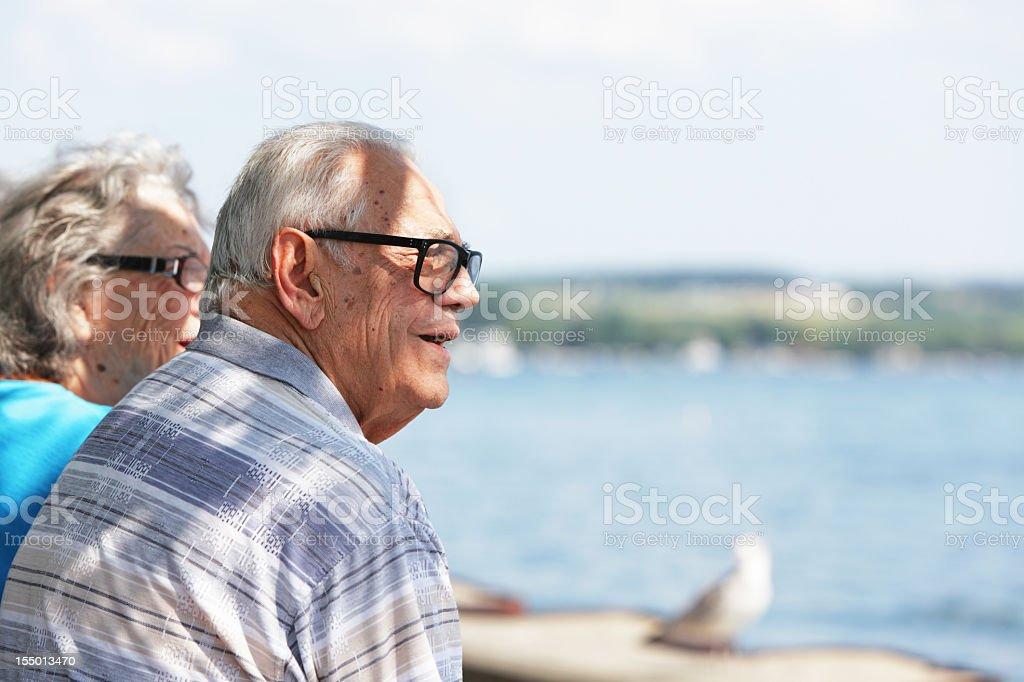 Senior People Watching Lake Activity royalty-free stock photo