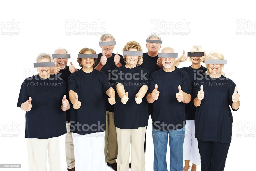 Senior people with eyes covered showimg thumns up stock photo