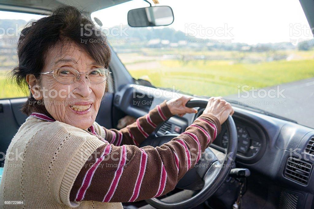 Senior person driving a car stock photo