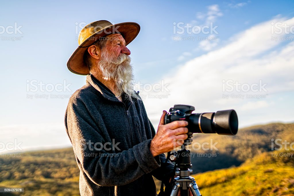 Senior Photographer in the Australia outback. stock photo