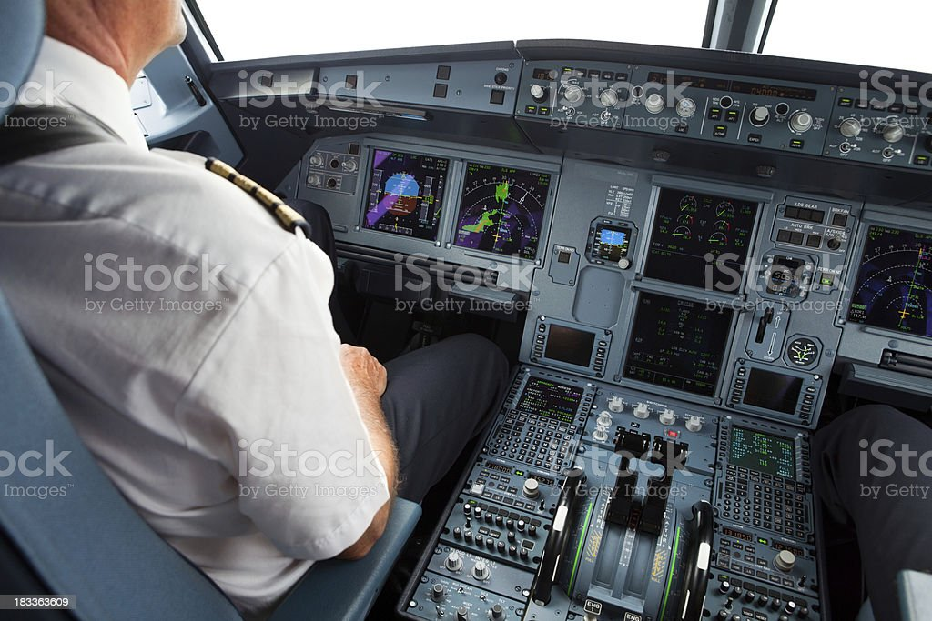 Senior pilot in the cockpit during a commercial flight royalty-free stock photo