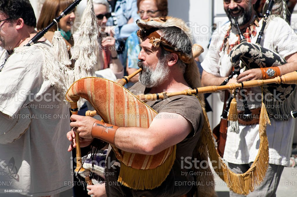 Senior pipers in a street artists folk band. stock photo