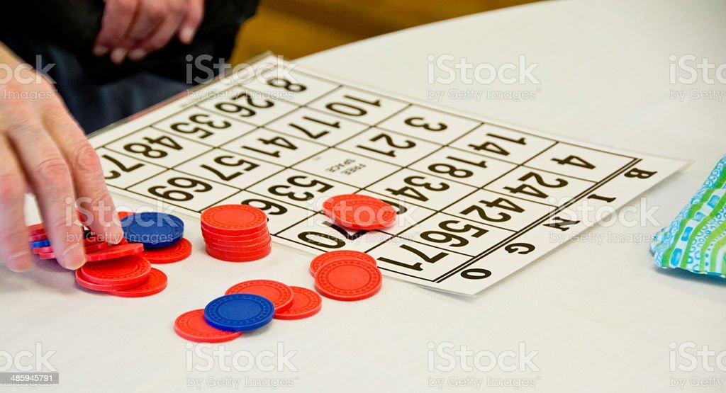 Senior playing bingo stock photo