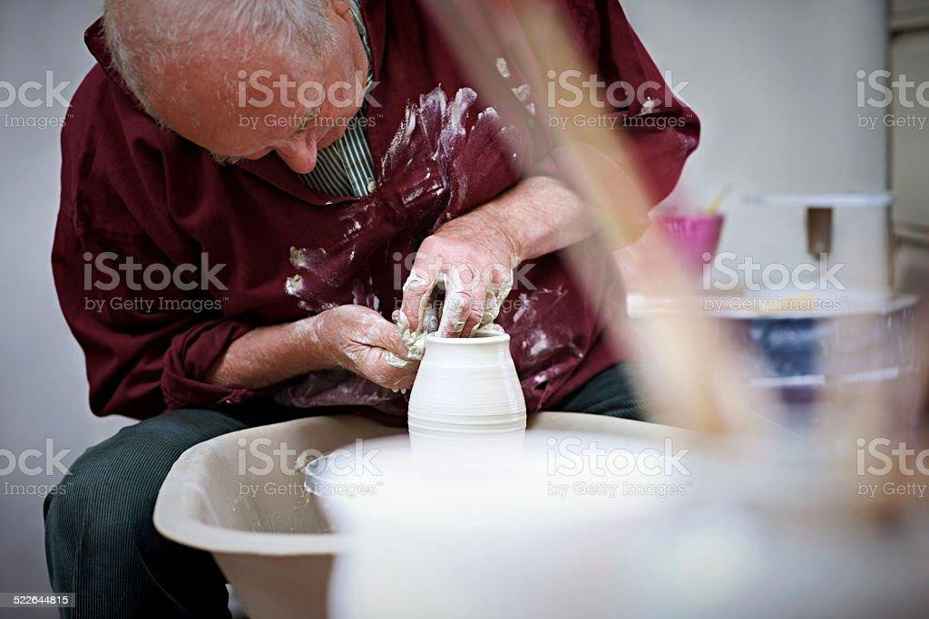Senior potter shaping pot stock photo