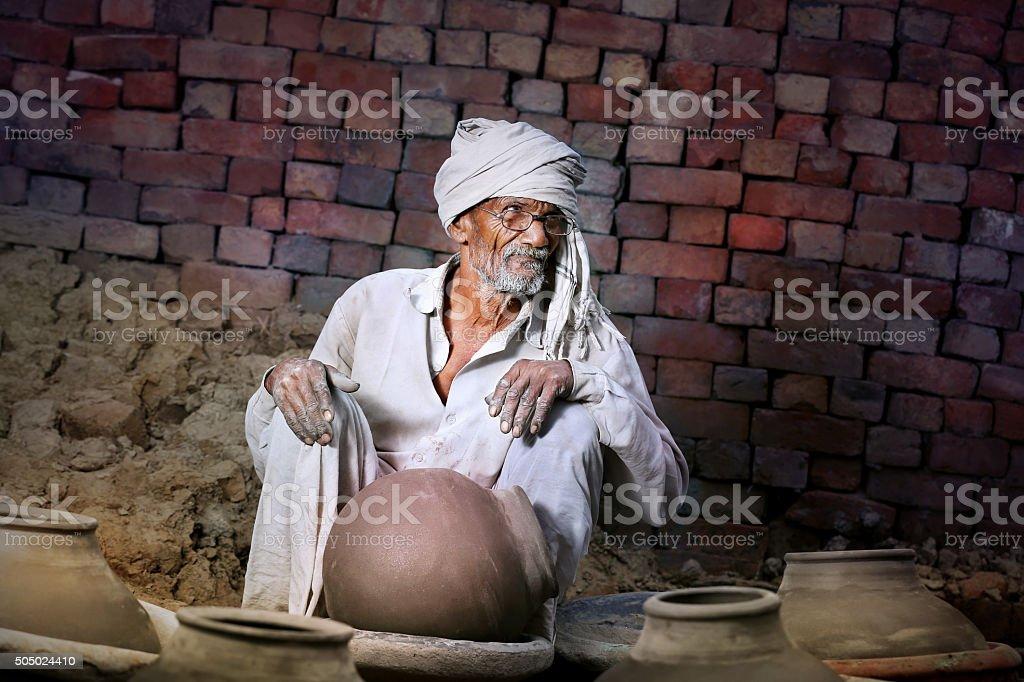 Senior Potter Sitting portrait at his home stock photo