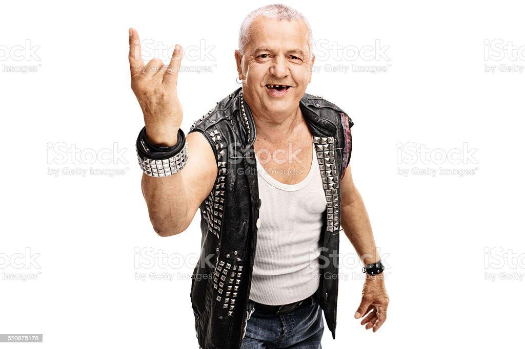 Senior punker making a hardcore gesture stock photo