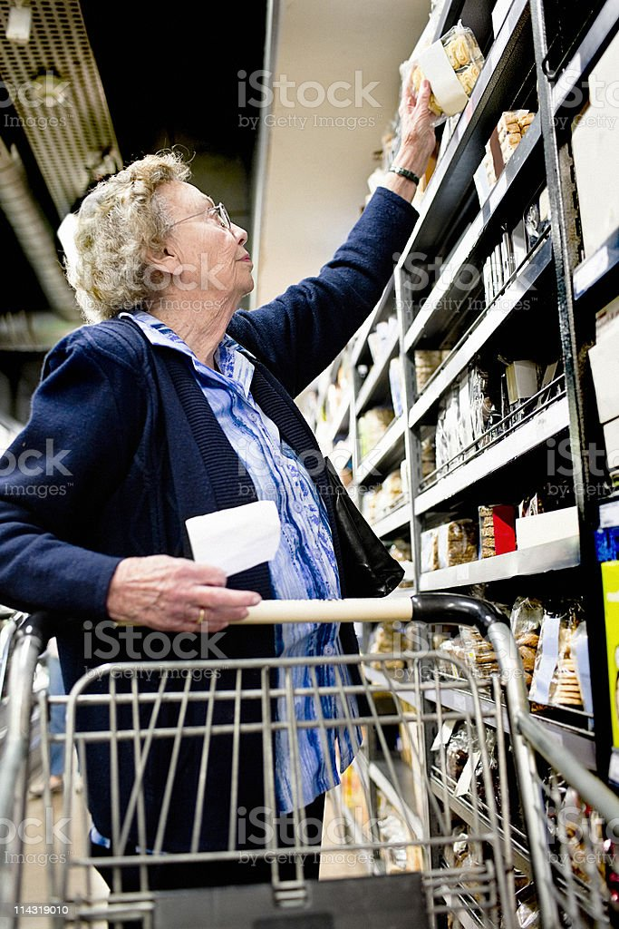 Senior reaching for biscuits stock photo