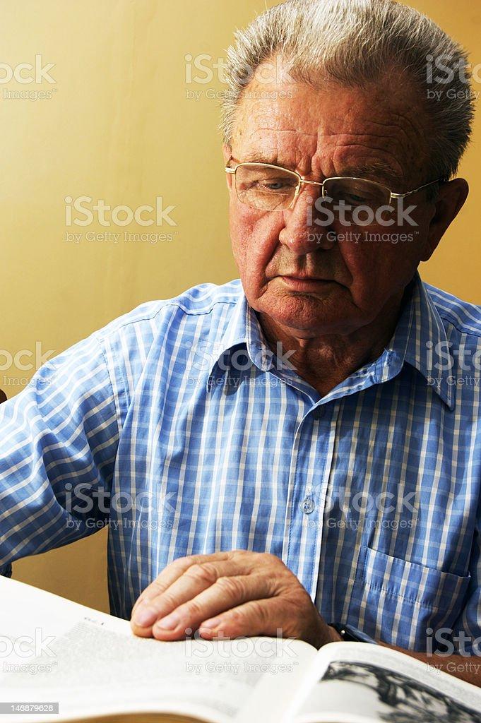 Senior reading book royalty-free stock photo