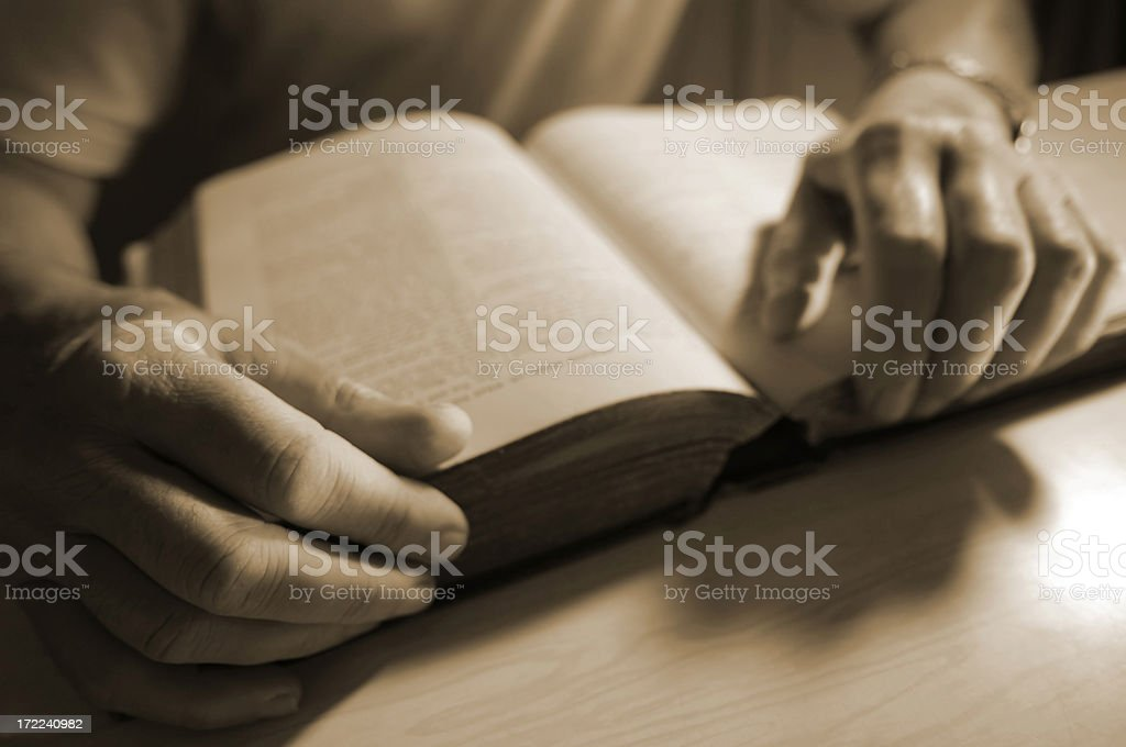 senior reading old book royalty-free stock photo