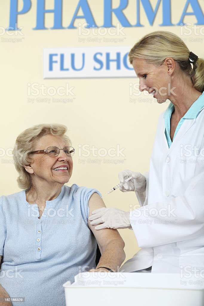 Senior Receiving A Flu Shot royalty-free stock photo